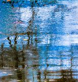 Colorful natures abstract refection from puddle. Natures abstract refection from puddle. Shot in Kentucky Photography art. Photography painting Stock Image