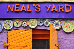 Colorful Neal's Yard, Covent Garden, London. Decoration with colorful painted plates in Neal's Yard, famous alley in Covent Garden, London Royalty Free Stock Photo