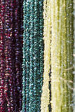 Colorful necklaces. Closeup of colorful necklaces hung on market stall Stock Photo