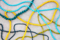 Colorful necklaces on concrete background royalty free stock images