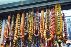 Colorful necklaces and jewelry in a market stock photo