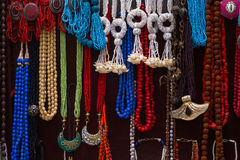Colorful necklaces at the market. Necklaces of different colors hanging at the market in India Stock Image