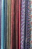 Colorful Neckties hanging on a rack royalty free stock image