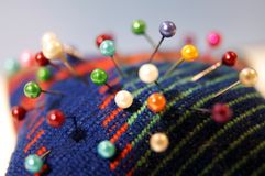 Colorful needle bed with pins. Colorful needle bed or pincushion with pins of different colors, close-up Royalty Free Stock Photo