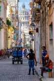 Colorful neighborhood in Old Havana with a view of the Capitol b Stock Photos