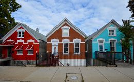 A Colorful Neighborhood. This picture is of three of a string of brightly colored homes located on the Southside of Chicago, Illinois.  This picture was taken on Royalty Free Stock Photos