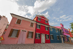 Colorful Neighbours. Traditional bright colored houses of Burano Island. Venice, Italy Royalty Free Stock Images