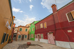 Colorful Neighbours. Traditional bright colored houses of Burano Island. Venice, Italy Stock Images