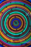 Rainbow circles neon. Colorful neon circles in yellow, blue, red and green royalty free stock image