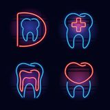Colorful neon health care signs. Set of red and blue neon signs for dental office. Signs are glowing in the dark night on brick wall background Stock Photo