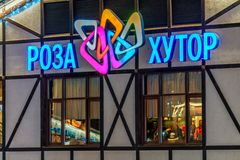Colorful neon illuminated Rosa Khutor ski mountain resort sign on building exterior. Rosa Khutor logo background. Sochi, Russia - January 4, 2018: Colorful neon stock photos