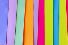 Colorful neon paper background. Striped geometric pattern of bright colors. stock photo
