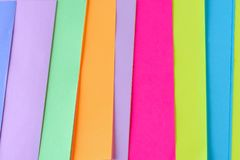 Colorful neon paper background. Striped geometric pattern of bright colors. stock photography
