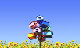Colorful nesting boxes and sunflowers Stock Image