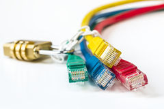 Colorful network cables secured lock with chain Royalty Free Stock Photography