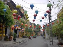 Colorful network of lanterns on the empty street royalty free stock photos