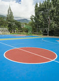 Colorful new Outdoor basketball court floor . Colorful new Outdoor basketball court floor and blue sky Royalty Free Stock Photo