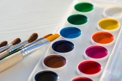 Colorful new watercolor paint pan set and brushes Royalty Free Stock Photography