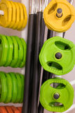 Colorful new weights in a gym or shop Royalty Free Stock Images