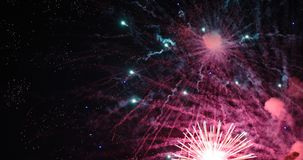 Colorful new year fireworks. Over dark sky Stock Photos