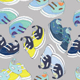Colorful newborn shoes for boys. Blue, green and yellow shoes with Seamless pattern. Vector illustration on light grey background. Hand drawn colorful newborn stock illustration