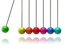 Colorful newton\'s cradle Royalty Free Stock Photography