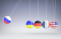 Colorful newtons cradle in action Royalty Free Stock Images