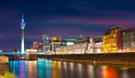 Colorful night scene of Rhein river at night in Dusseldorf. royalty free stock images