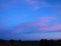 Colorful Night Sky. Sun setting over the field creates a beautiful array of colors Royalty Free Stock Photography