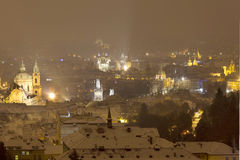Colorful night snowy foggy Prague City, Czech republic Royalty Free Stock Photography
