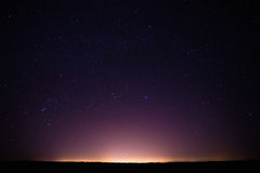 Colorful Night Starry Sky Above The Yellow City stock photos