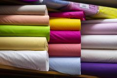 Colorful non-woven fabric rolls - material fabric royalty free stock photography