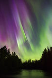 Colorful northern lights (Aurora borealis) in the sky. By the river royalty free stock image
