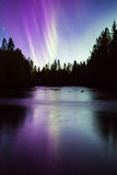 Colorful northern lights (Aurora borealis) in the sky. By the river royalty free stock photography