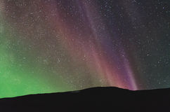 Colorful northern lights over the horizon Royalty Free Stock Images