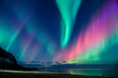 Free Colorful Northern Lights Spiral In A Iceland Beach Stock Image - 162078911