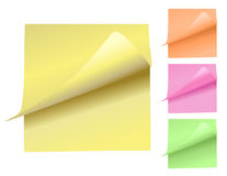 Colorful Note Pads Peeling Up. Choose from a variety of colors of sticky note pads in yellow, orange, pink and green. The note pad is curling upwards revealing Royalty Free Stock Photos