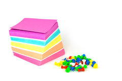 Colorful note paper and pins isolated on a white background. Close up Stock Photography