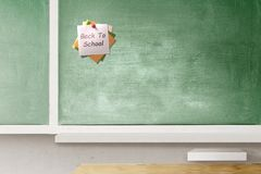 Colorful note paper in push pin with Back to School text on chalkboard in the classroom stock photos