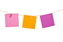 Colorful note papers. Drying on the rope Stock Photo