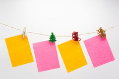 Colorful note papers hanging rope stock images