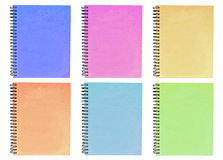 Colorful notebook. The Colorful notebook have green pink brown blue on white background stock photo