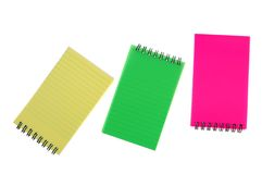 Colorful notebooks. Some tiny colorful notebooks on white royalty free stock photos