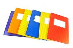 Colorful notebooks isolated on white background Stock Image