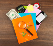 Colorful notebooks with magnifier Royalty Free Stock Image