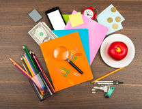 Colorful notebooks with office supplies and apple Stock Photos