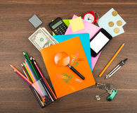 Colorful notebooks with office supplies Royalty Free Stock Photography