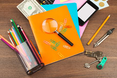 Colorful notebooks with office supplies, top view Stock Photo