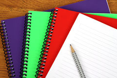 Colorful notebooks ond pencil. Close up of some colorful notebooks ond pencil Stock Photo