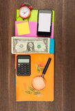 Colorful notebooks with smartphone Stock Image